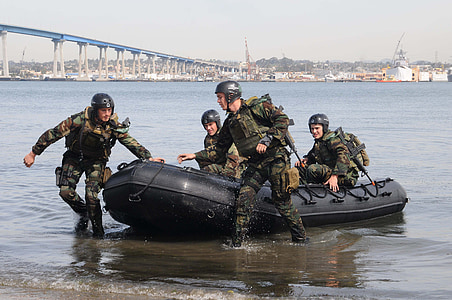 army riding inflatable boat