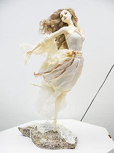 woman in gray midi dress figurine