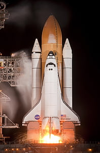 lunching Nasa Space shuttle during night time
