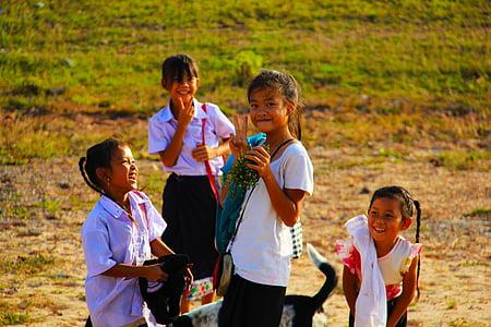 children standing on grass field