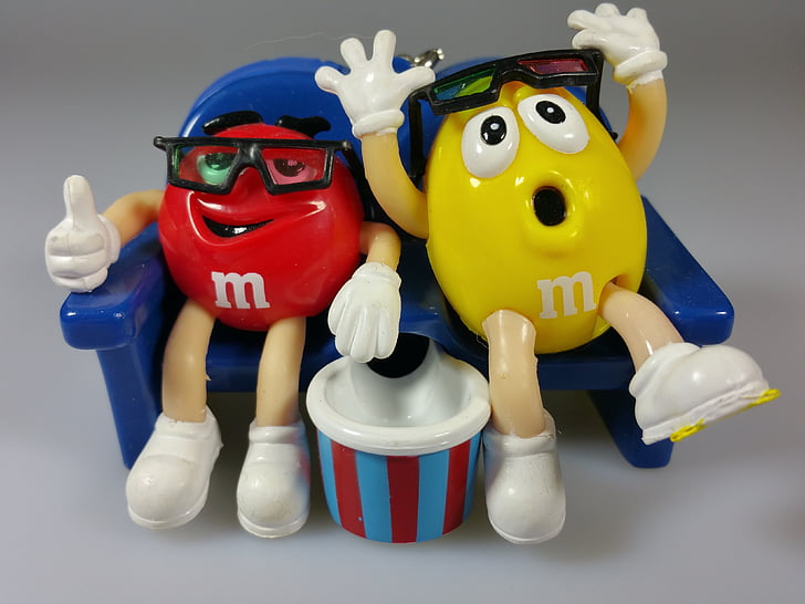 two red and yellow M&M's figurines