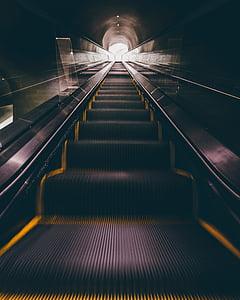 photography of underground escalator