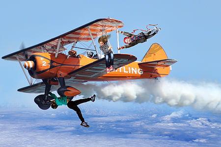 edited photo of bi-plane on air