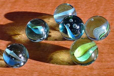 close-up photo of six marble balls