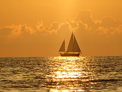 black sailboat on body of water