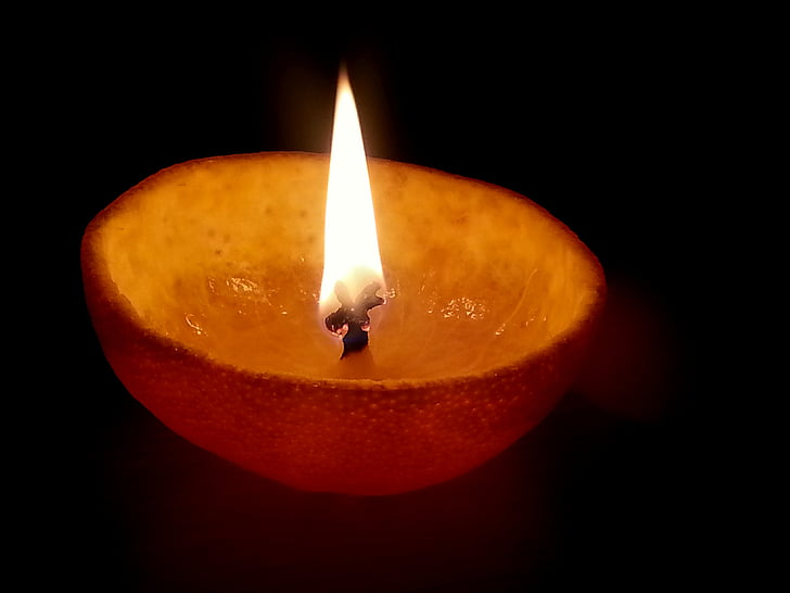 shallow focus photography of oil candle