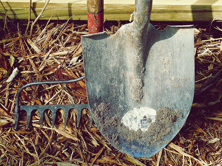 gray shovel and gray rake