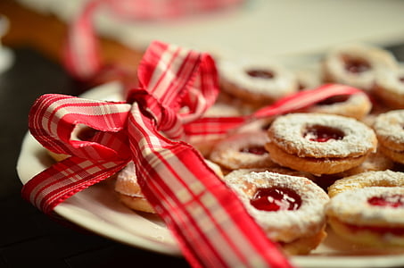 cookies with strawberry jam on white ceramic plate