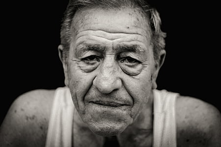 grayscale photography of man wearing tank top