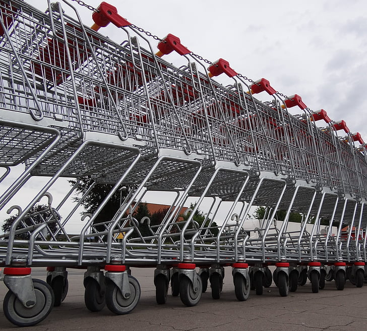 photo of gray steel shopping cart lot during daytime