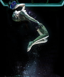 woman swimming on water