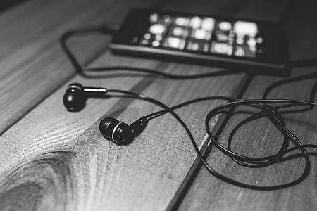black in-ear headphones