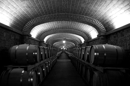 grayscale photo of wine cellar