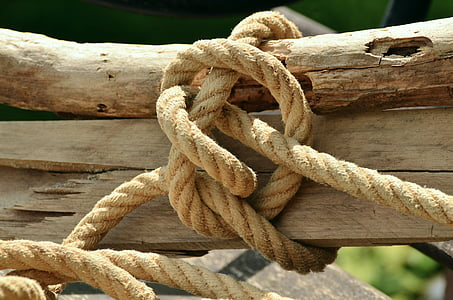 brown rope tied on a brown wooden trunk