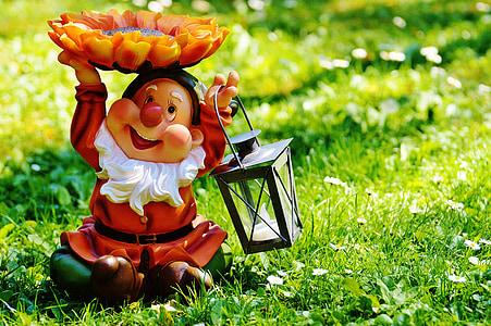 orange dwarf ceramic figurine
