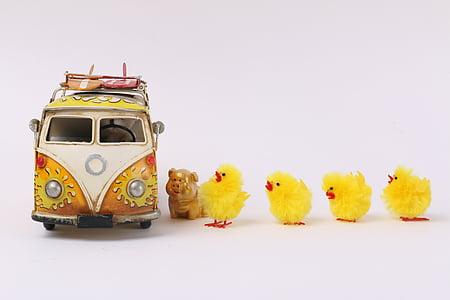 four chick toys near bur toy