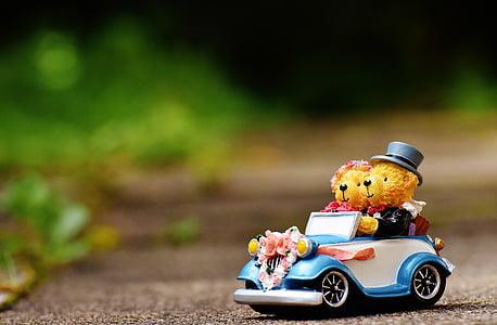 two bears riding vehicle figurine
