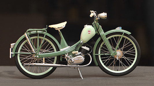 teal and green pedal moped bike