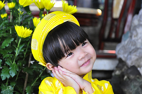girl wearing yellow top
