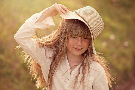girl wearing beige hat