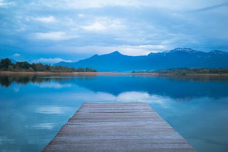 boardwalk; bodies of water; mountain range