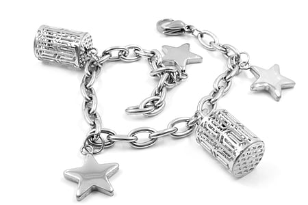 silver-colored charm bracelet on white surface