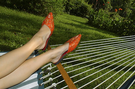 woman wearing pair of red shoes