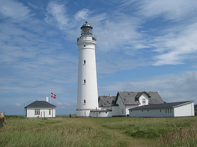 white lighthouse and grass field