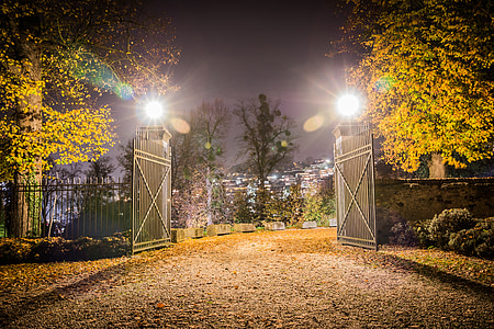 landscape photo of opened gate during nighttime