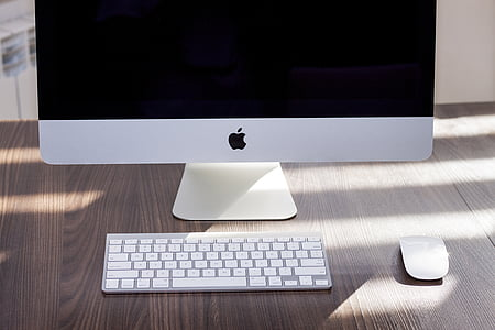 silver iMac near Apple Wireless Keyboard and Apple Magic Mouse