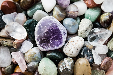 white, black, and purple stones