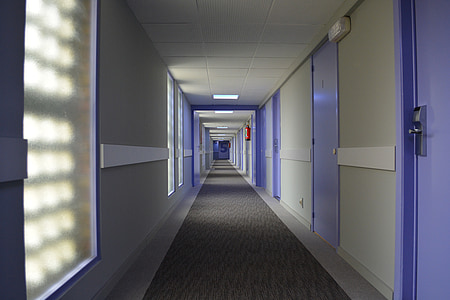 photography of white hallway