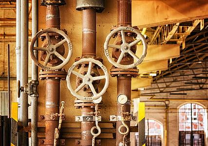 three brown steel valves
