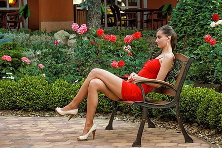 woman in red dress sitting on bench