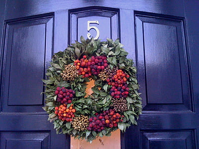 closed door with flower wreath hanged on it