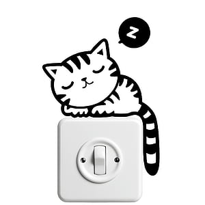 cat illustration on top of white electric switch