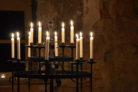 lit candles on candle holder