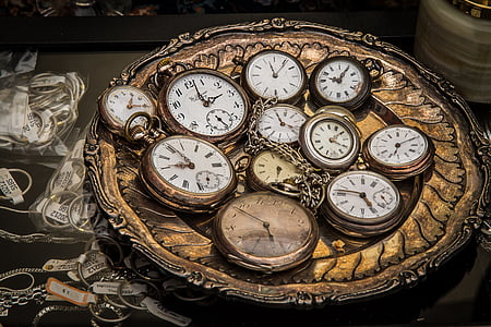photo of round gold-colored pocketwatch lot