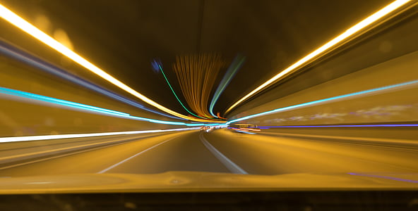panning photo of tunnel roadway