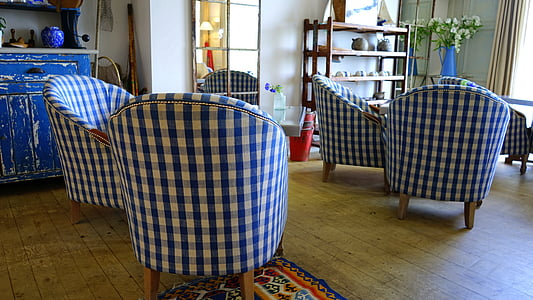 blue and white checked chairs in room