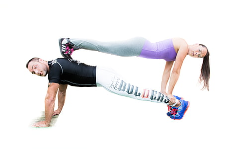 man wearing black short-sleeved doing pushup with woman above him