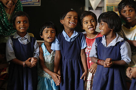 children wearing school uniform making smiling face