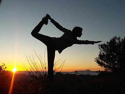 silhouette photo of person doing yoga position