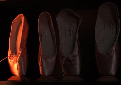 four assorted-color ballet shoes