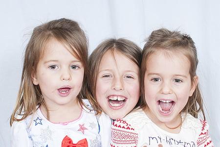 three children wearing white shirts