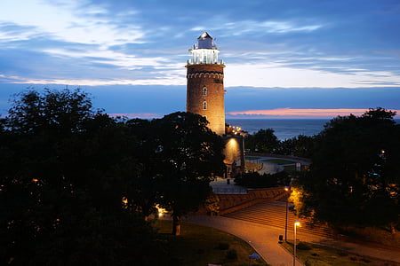lighthouse near trees