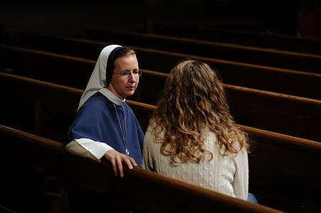woman talking to a nun