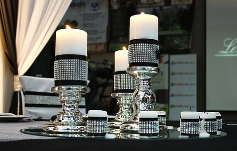 black-and-silver candlesticks and tealight candle holders