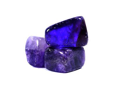 three purple gemstones