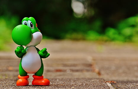 Yoshi standing on brown pavement